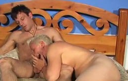 Blond sucks a mature's dick on bed