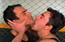 Two latin guys kiss with passion