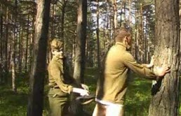 Soldier gets spanked by another in the forest