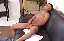 Horny latin guy stroking his big cock on camera