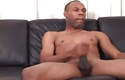 Horny black guy strokes his dick in front of the camera