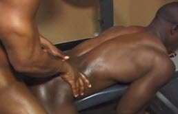 Big and muscular black has anal sex in the gym