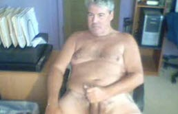 Fat mature touches his cock in front of the camera