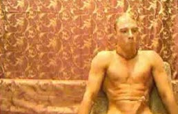 Muscular blond with an erection in front of the camera