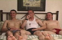Three young guys suck their cocks and have anal sex