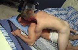 Horny blond sucks another guy's dick