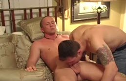 Horny guy masturbates while two perverts have anal sex near him