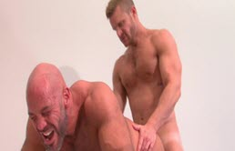 Muscular mature gets ass fucked hard by a blond