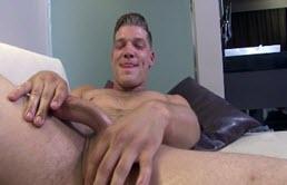 Muscular man masturbates at a casting