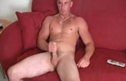 Mascular dude masturbates hairy cock
