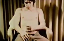 Gay takes out his cock and masturbates in vintage video