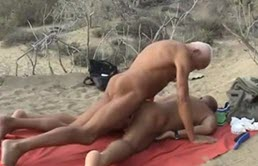 Mature couple have sex at the beach