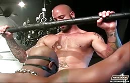 Interracial BDSM scene with a big black cock