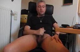 Mature gay man masturbates his cock