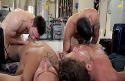 Four guys having a group sex scene