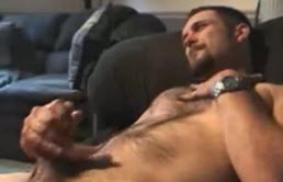 Hairy guy masturbates his big cock